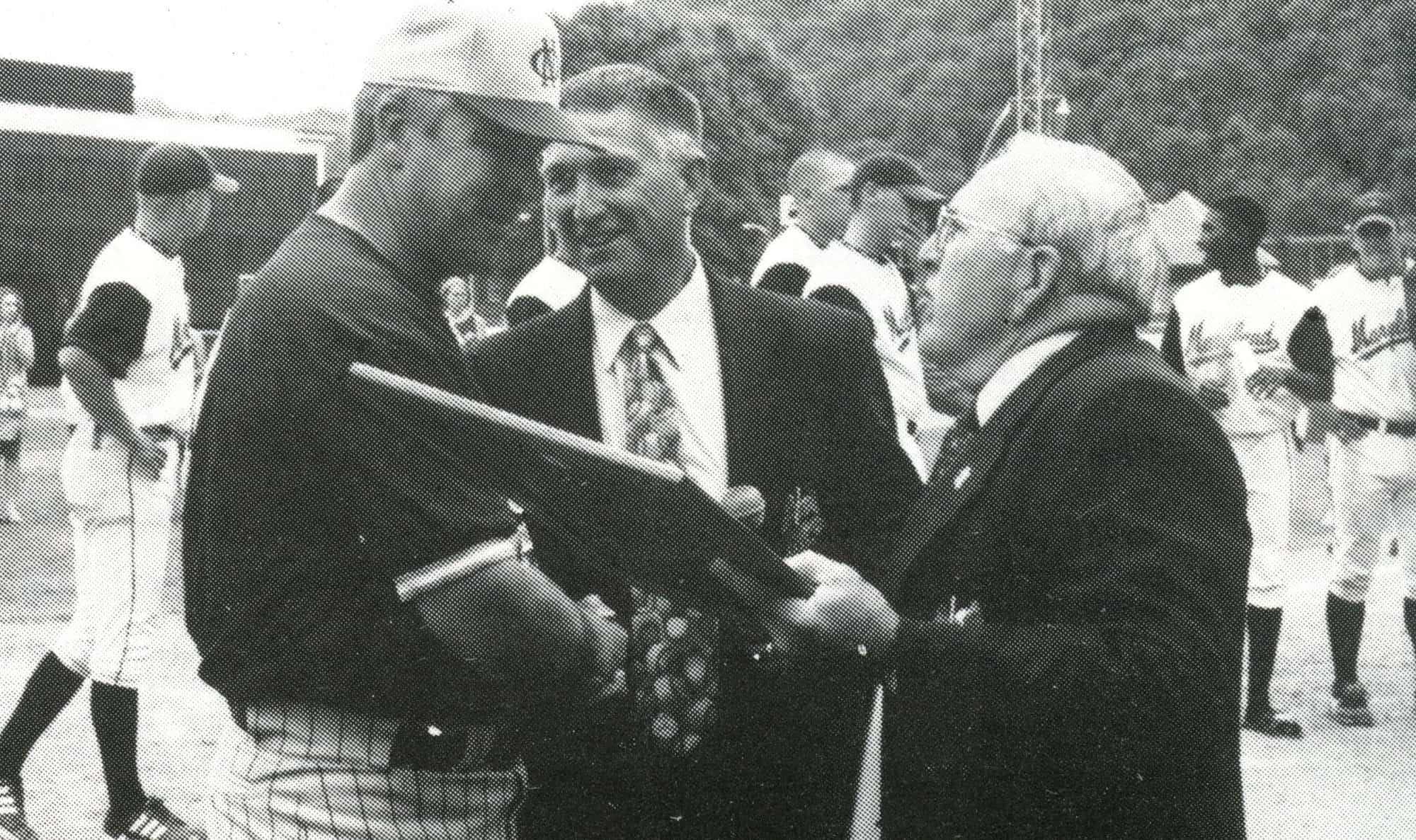 New Orleans MGR Joe Scheuermann received 2000 championship trophy from James Wright