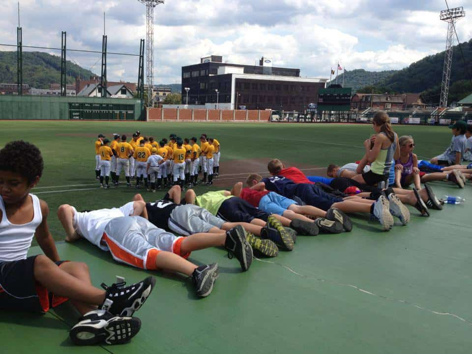 Kids on Dugout waiting for New Orleans players