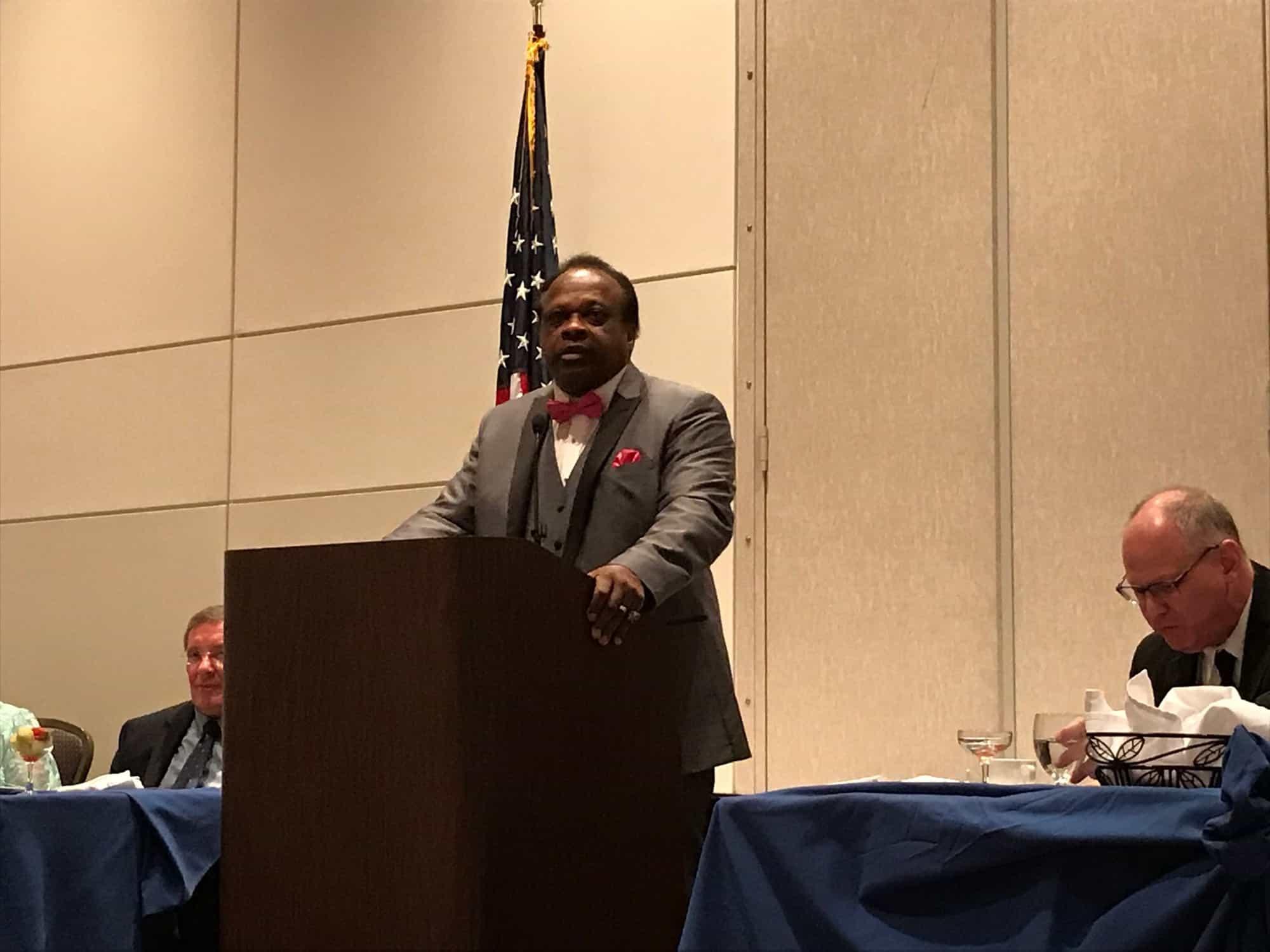 Al Oliver at podium